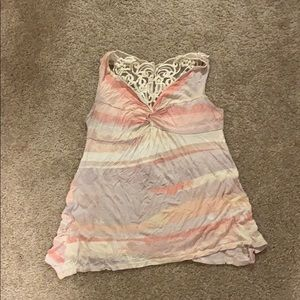 Tank top with lacing on the back. Size large